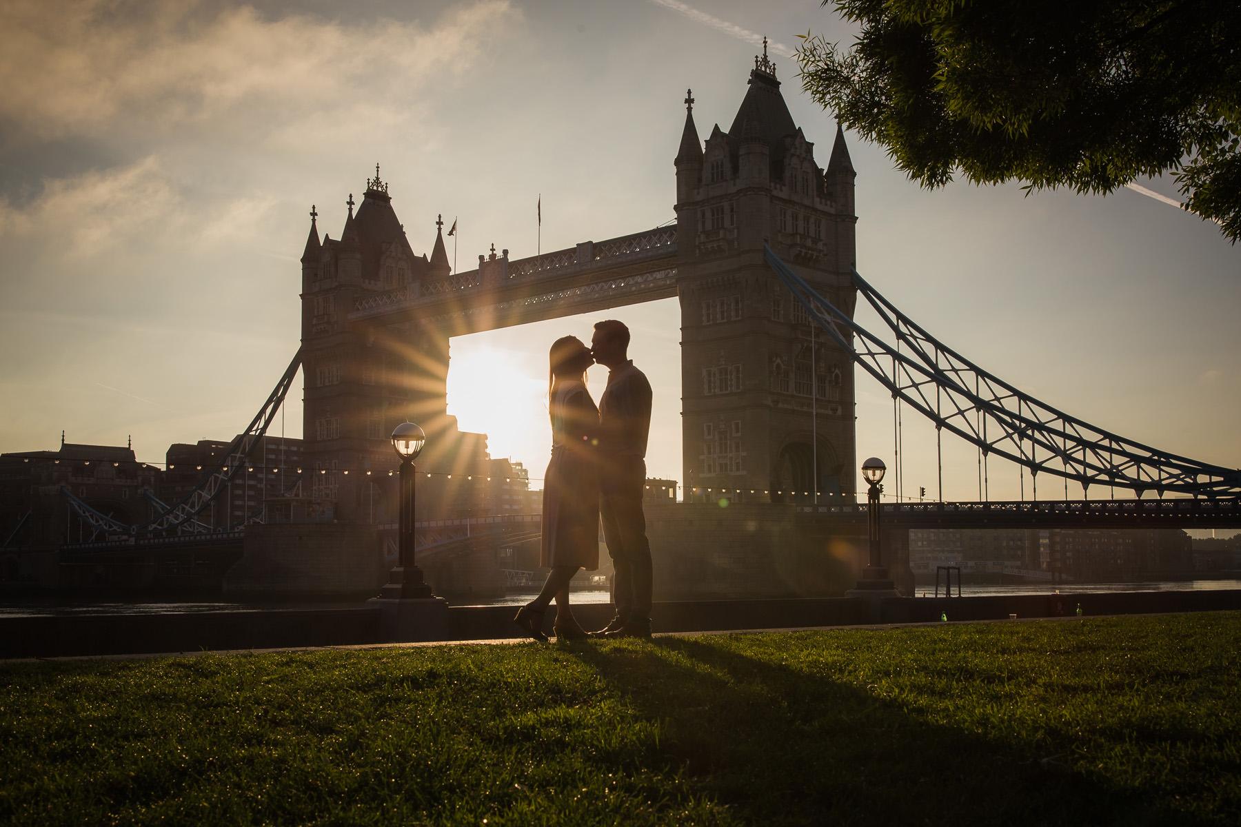 Couple portrait in front of Tower Bridge in London, by Karen Julia Photography