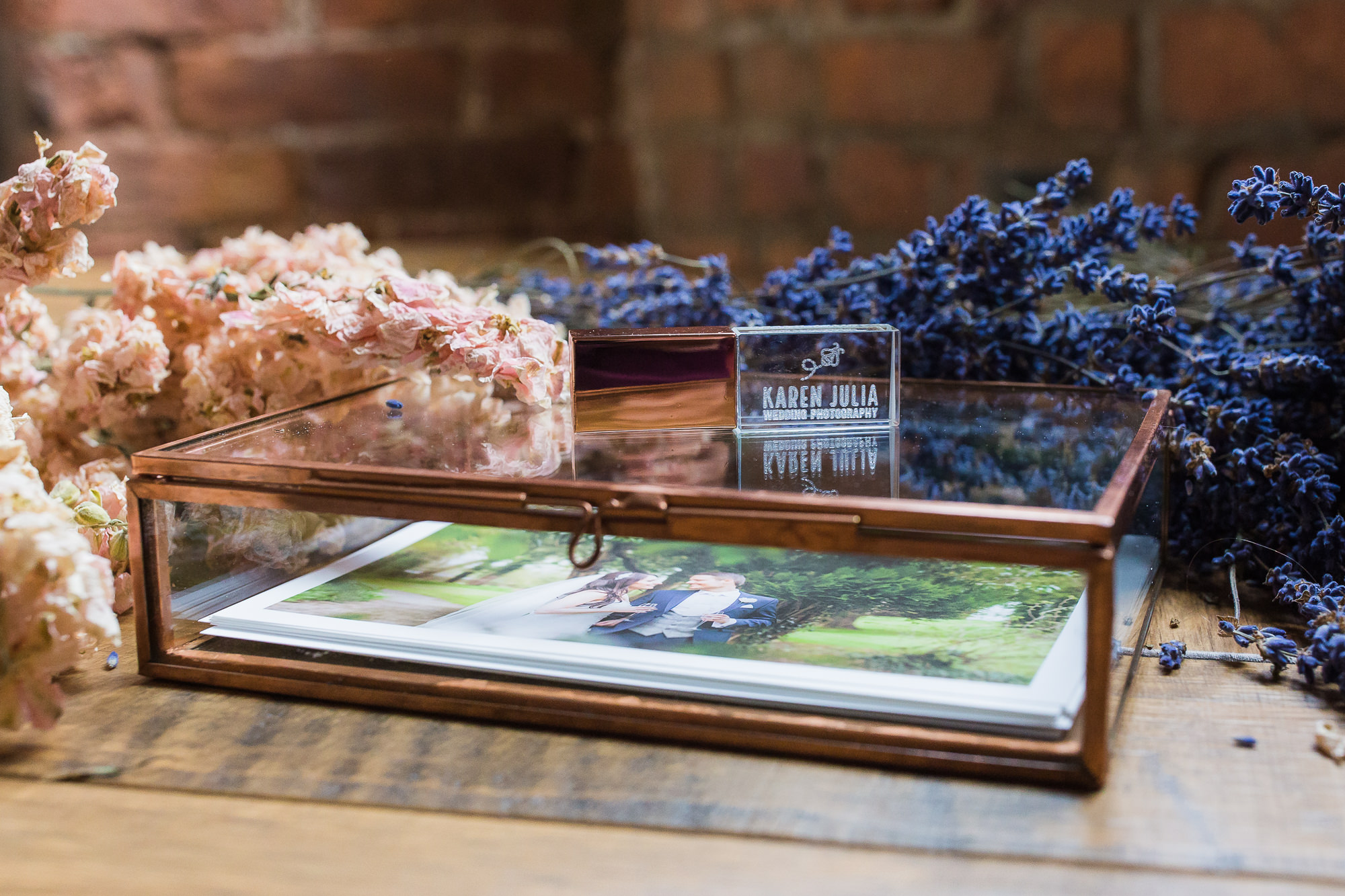 rose gold coloured glass box with fine art prints