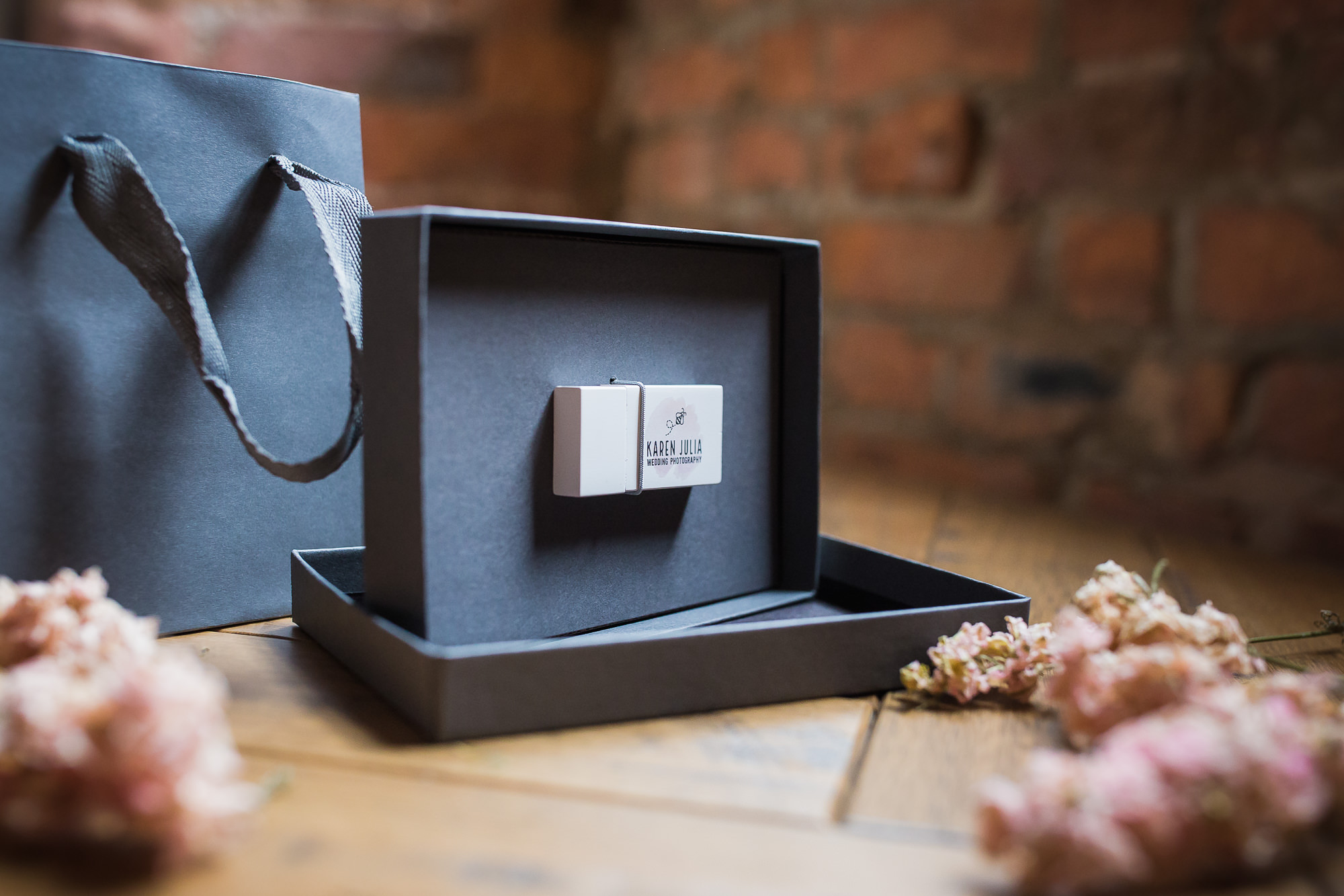 wooden USB with Karen Julia Photography bee logo shown in charcoal craft box