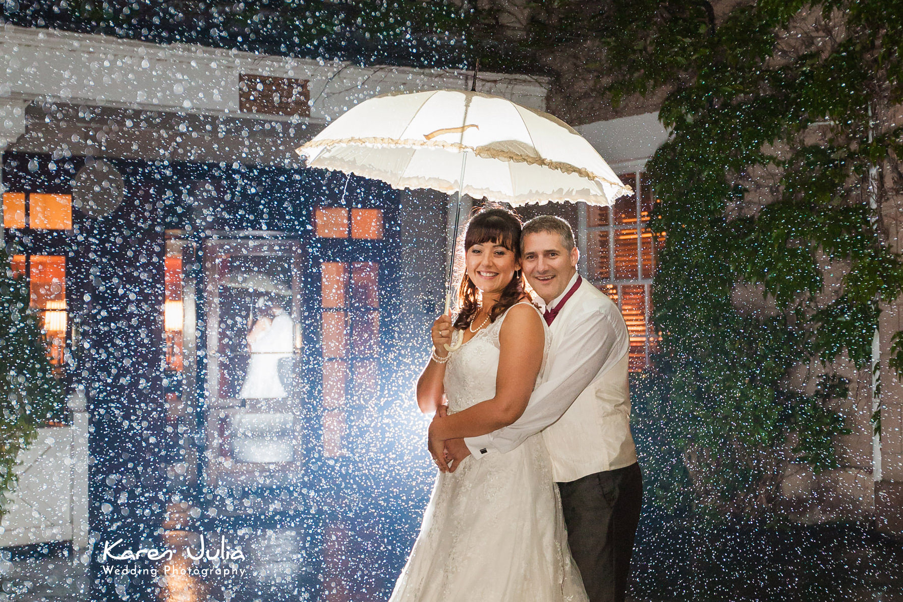 bride & groom portrait in rain by karen julia