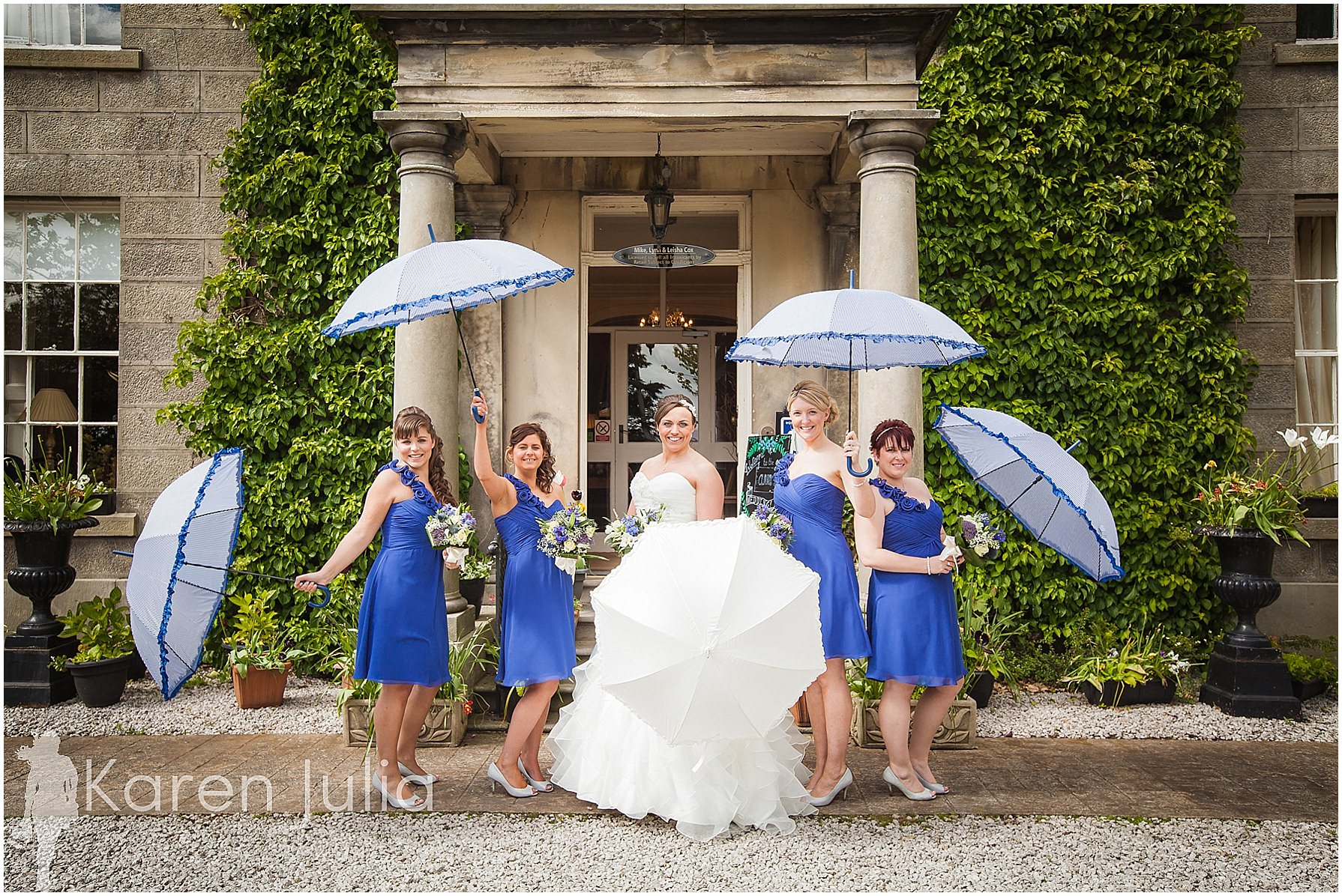 bridesmaids with umbrellas spring house hotel