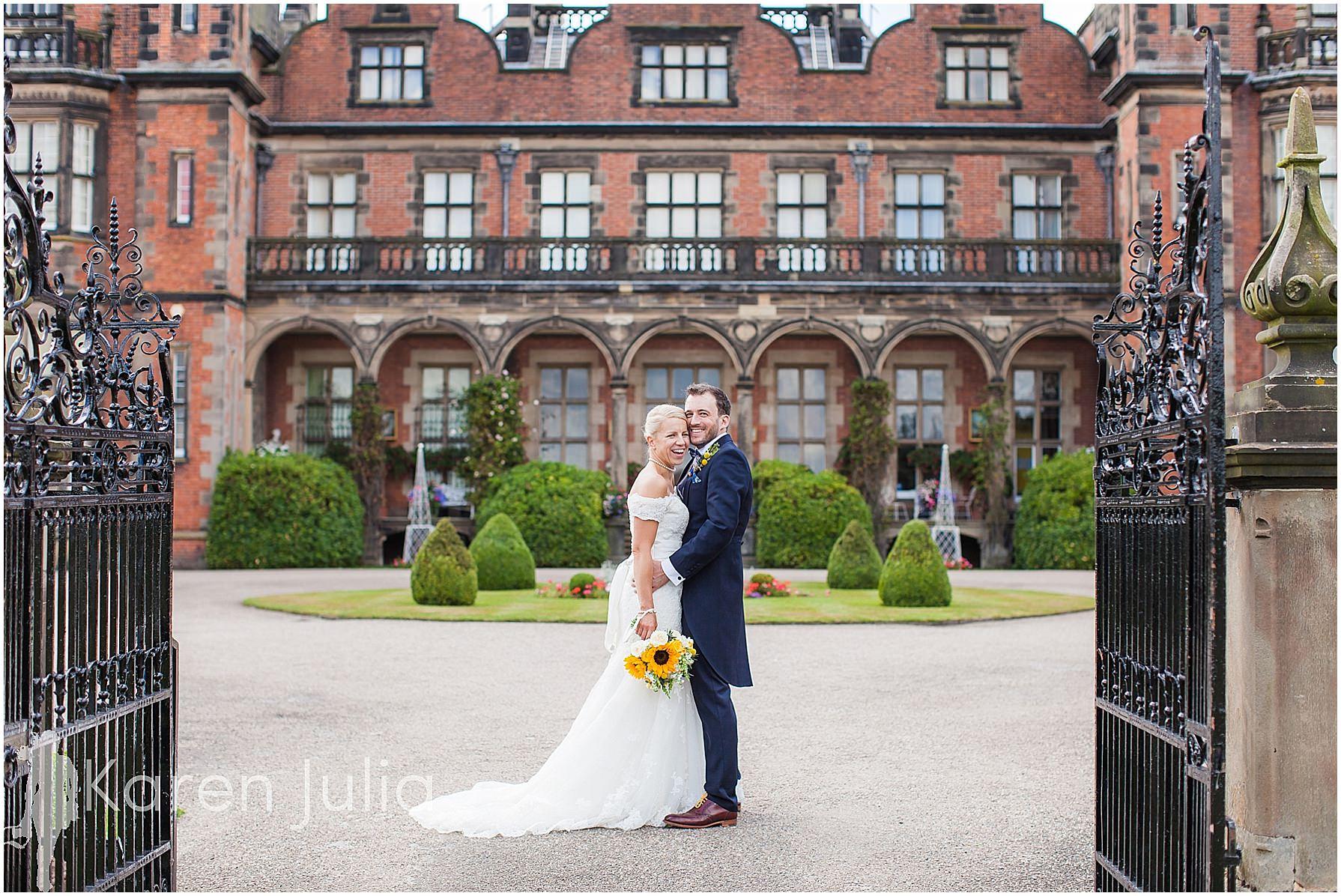 bride & groom outside capesthorne hall