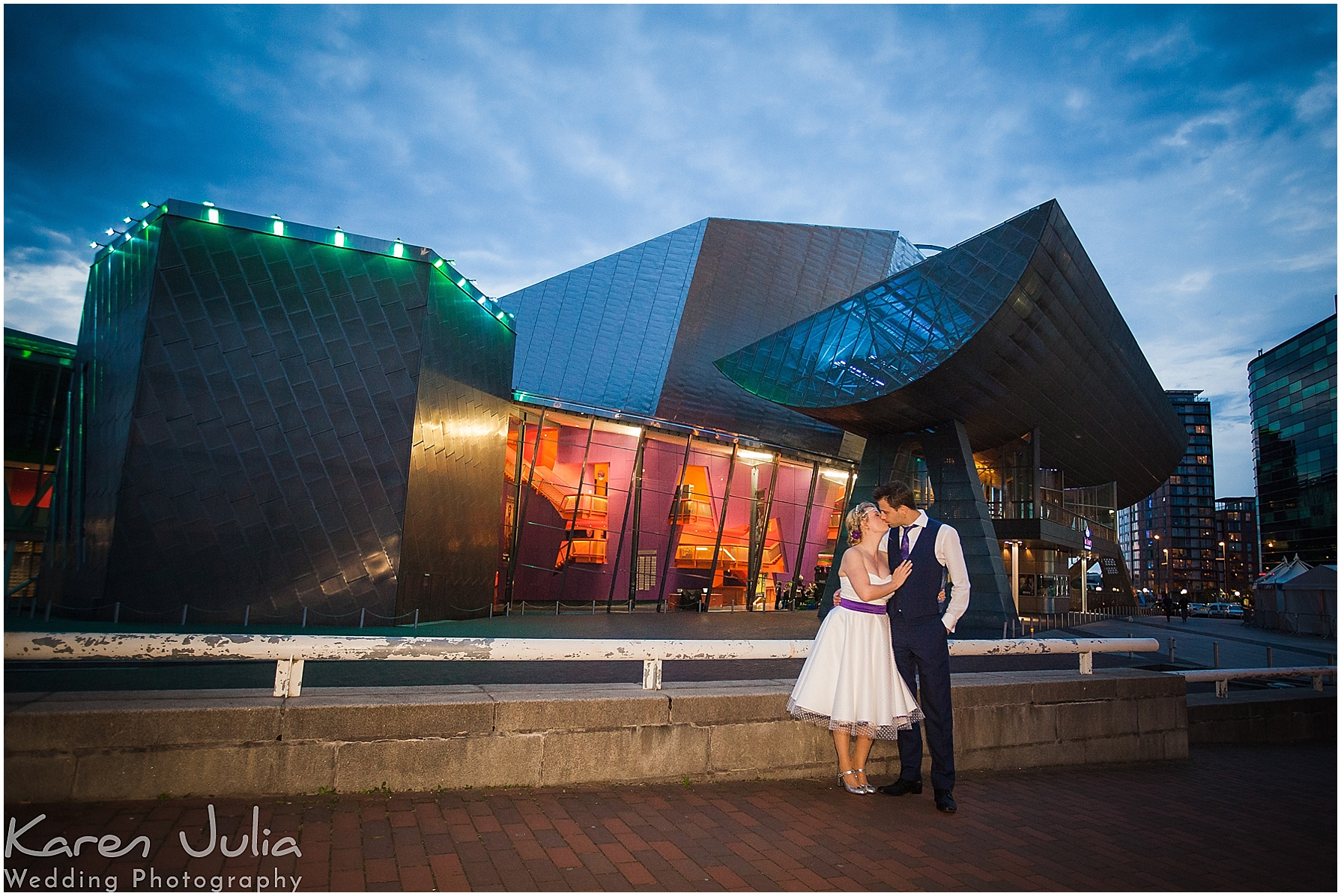 night bride and groom portrait outside lowry theatre