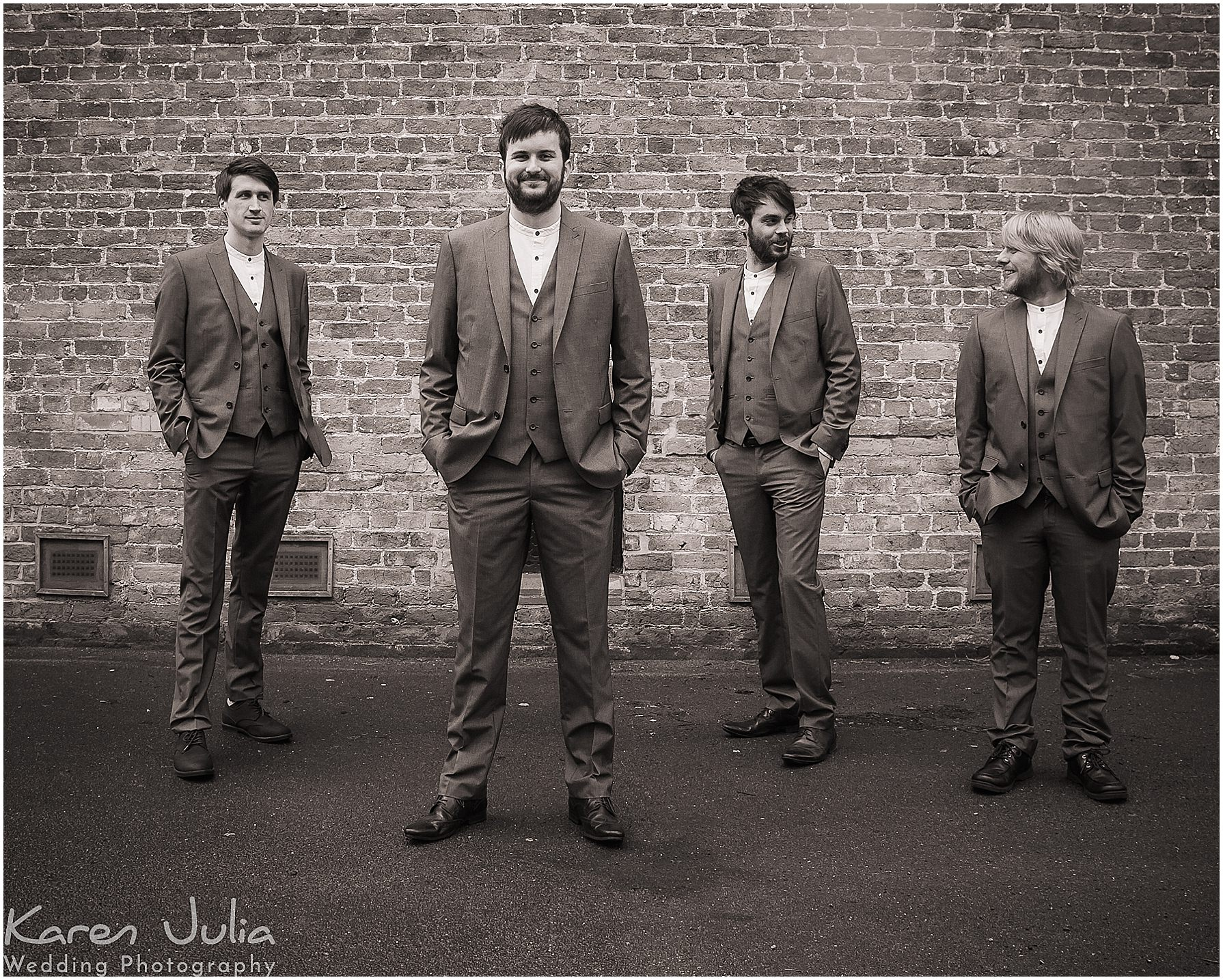 groom and groomsmen outside chancellors hotel manchester