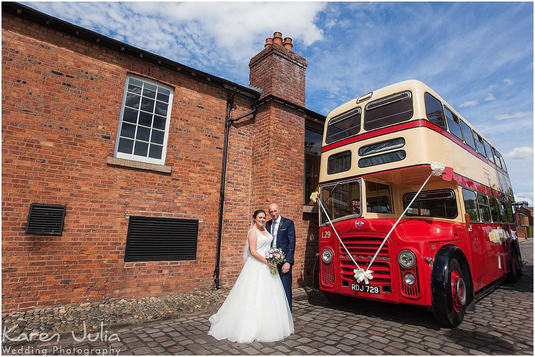 Bride and Groom outside Castlefield Rooms wedding venue with vintage red and cream double decker bus