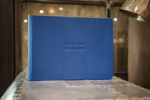 Graphistudio wedding book in blue leather with debossing of names