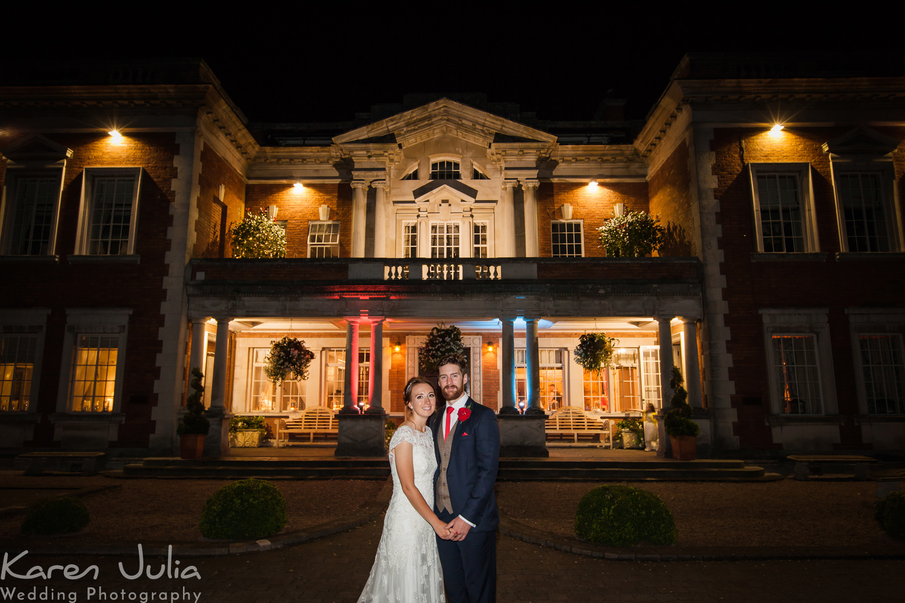 bride and groom portrait at night at Eaves Hall