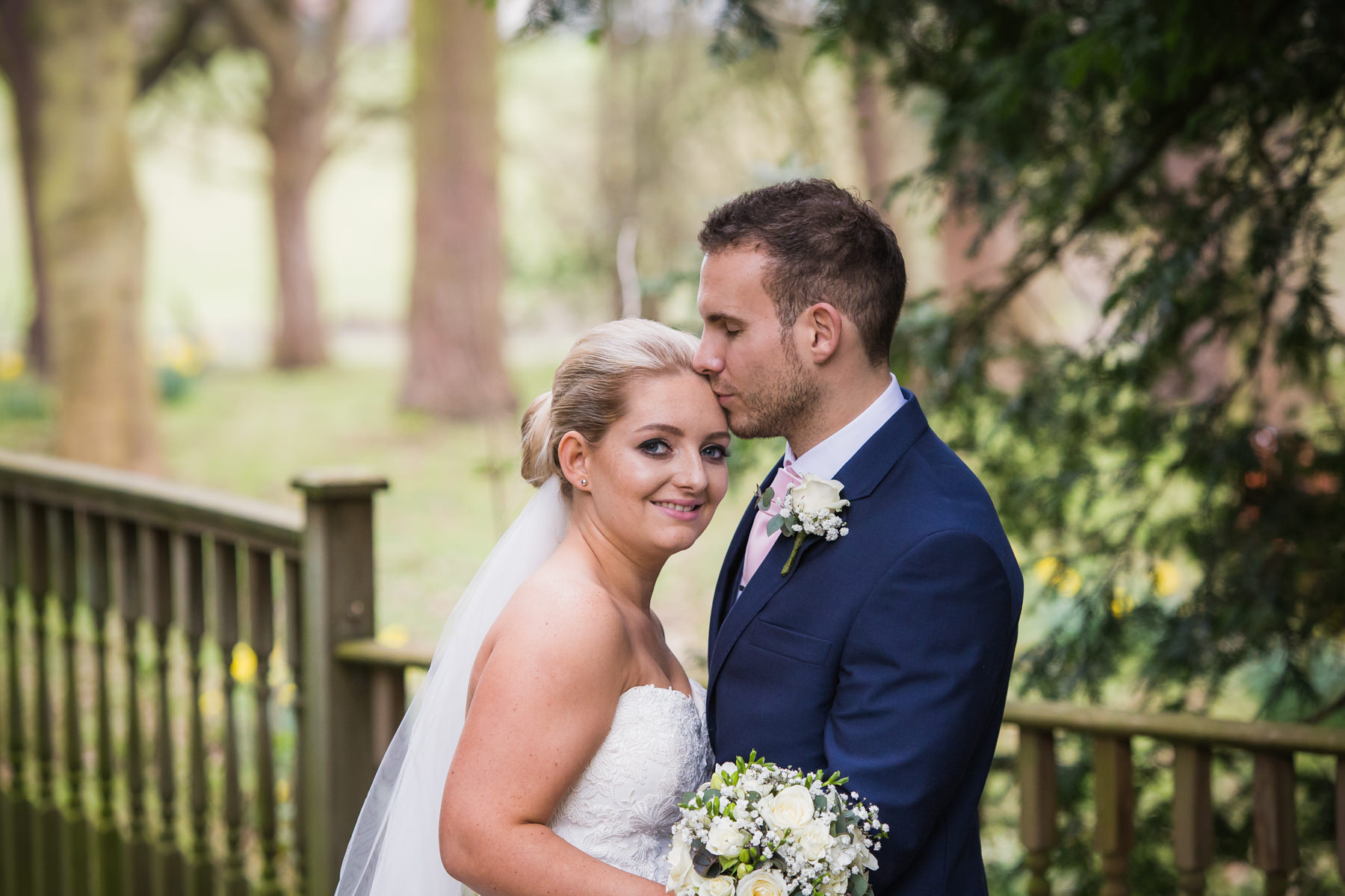 bride and groom portrait during their Classic & Elegant Deanwater Hotel Wedding
