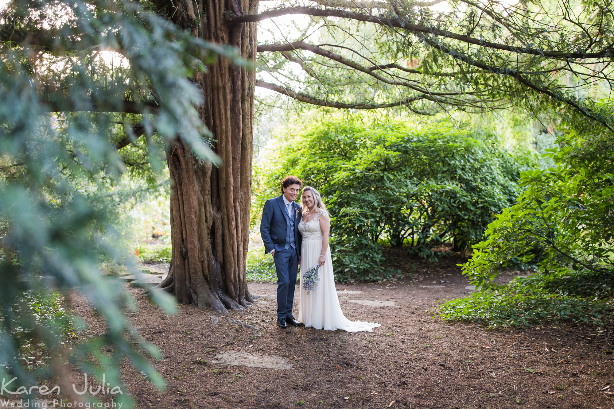 bride and groom in Parsonage gardens at their Rustic Didsbury Parsonage Wedding