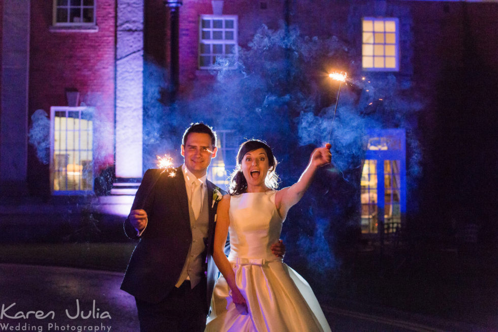 bride and groom portrait with sparklers at Mottram Hall