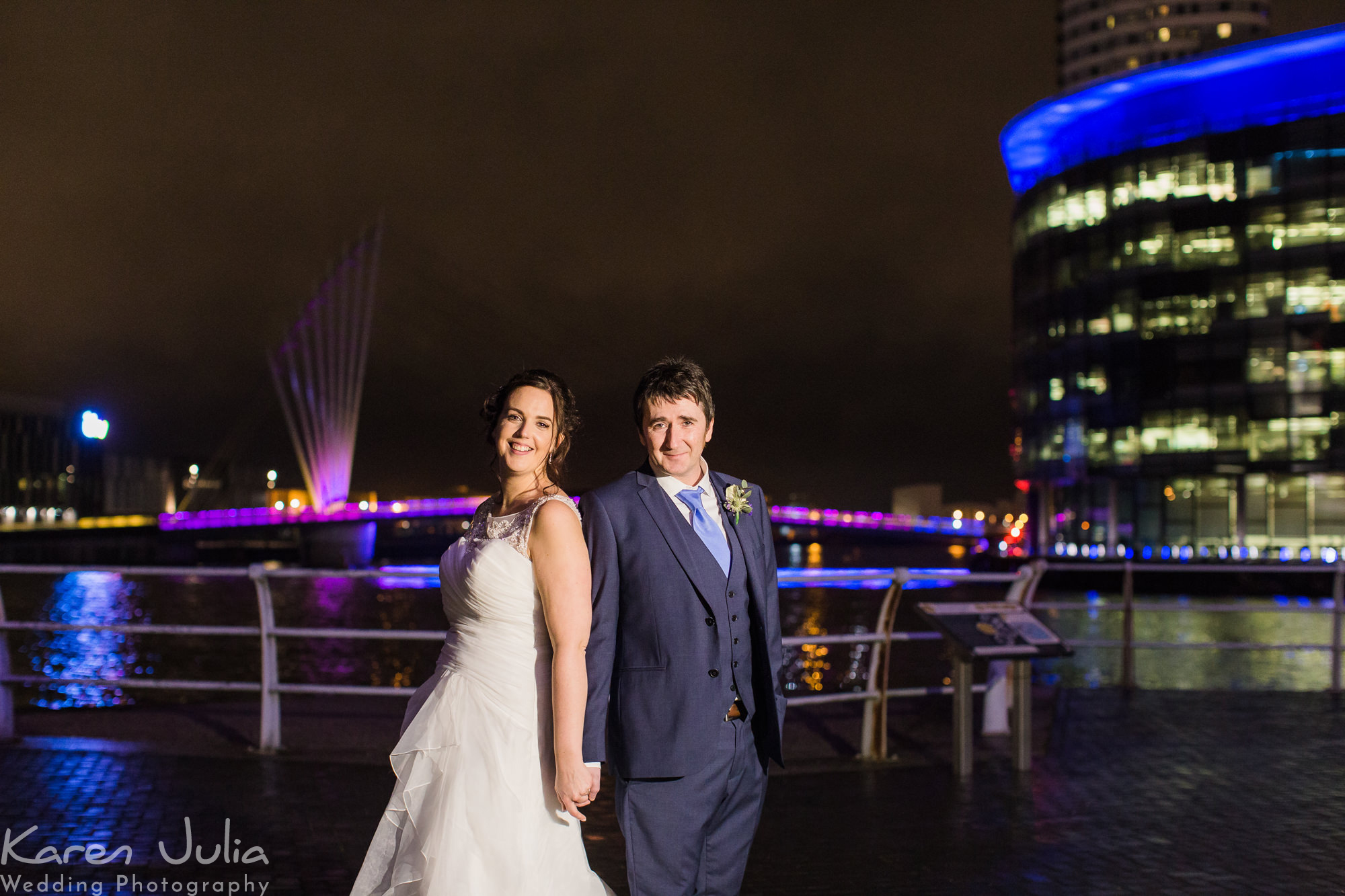 bride and groom portrait at night at their Lowry Theatre Winter Wedding