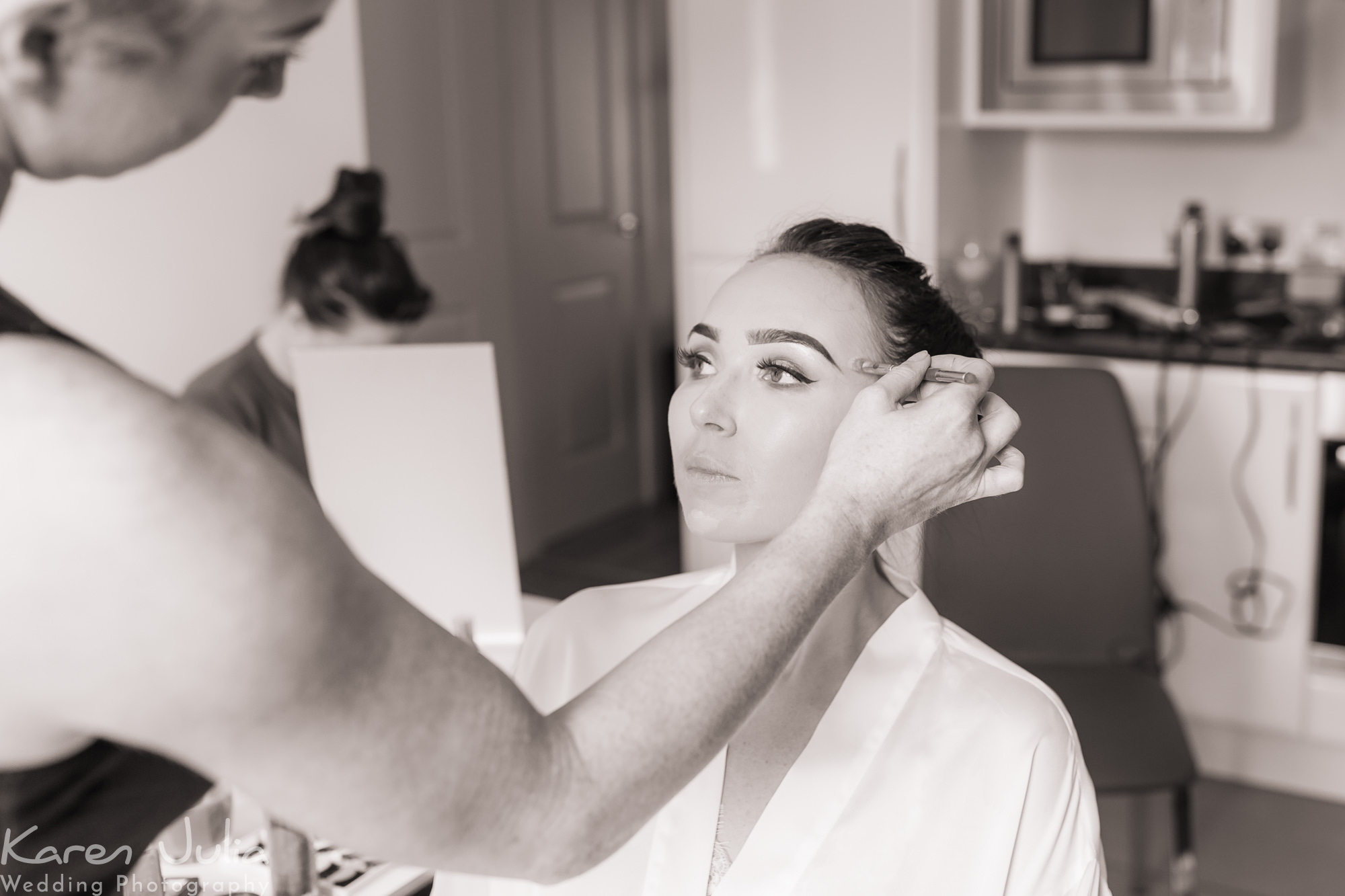 make-up being applied during morning bridal preparations