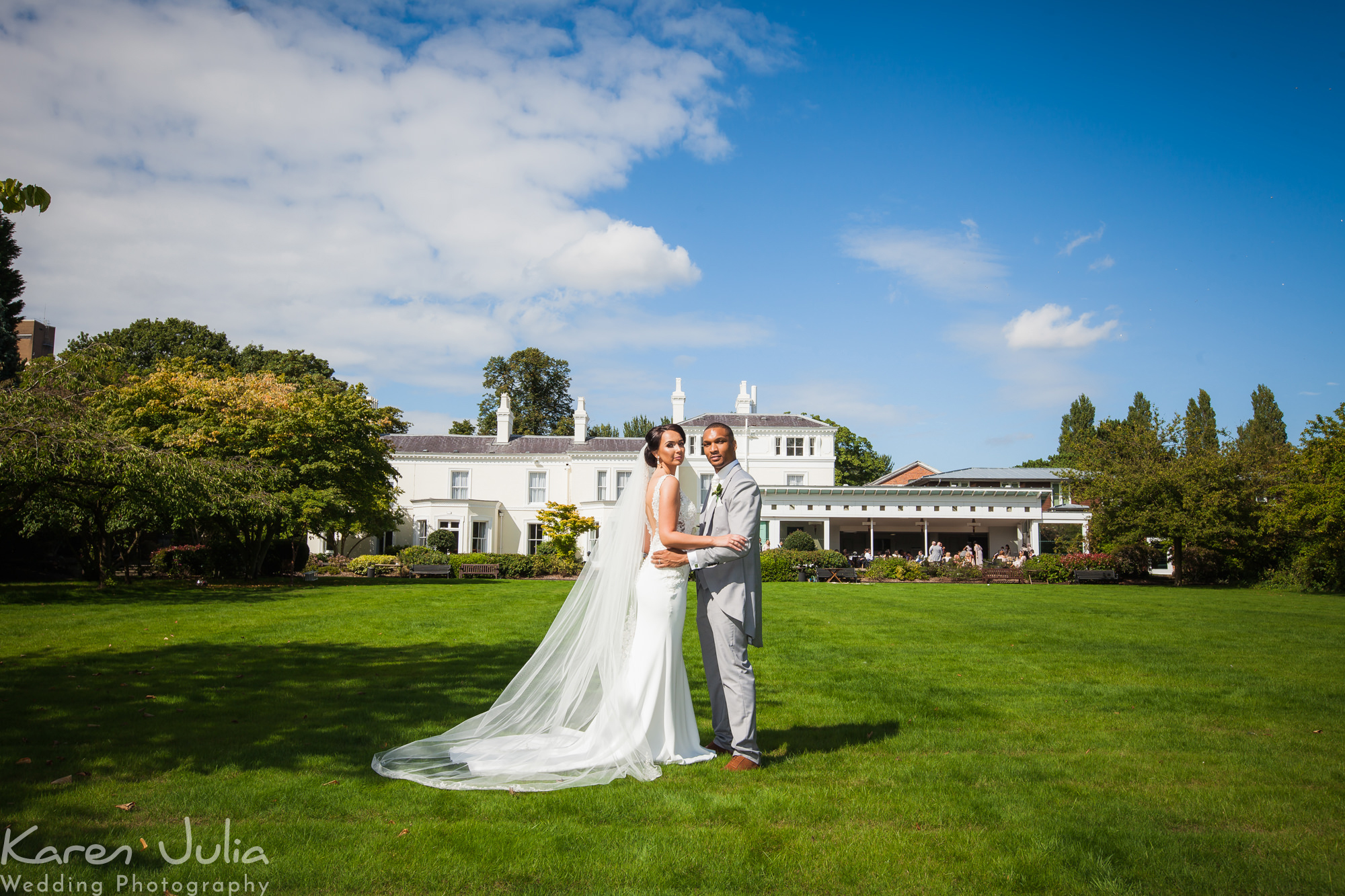 bride and groom portrait with Chancellors Hotel in the background