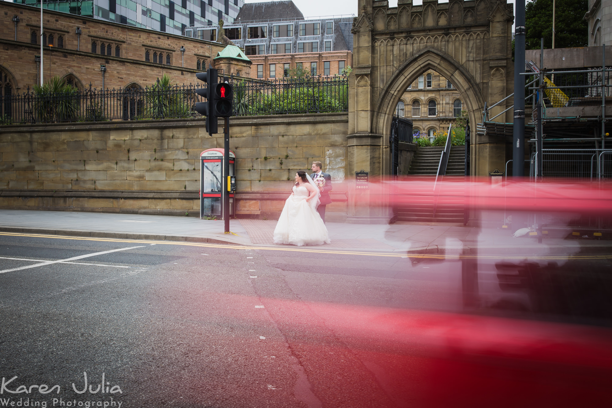 bride and groom portrait with traffic