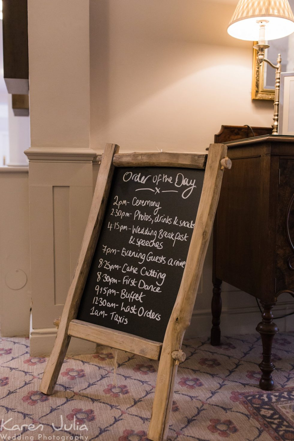 chalk board at wedding showing timings for guests