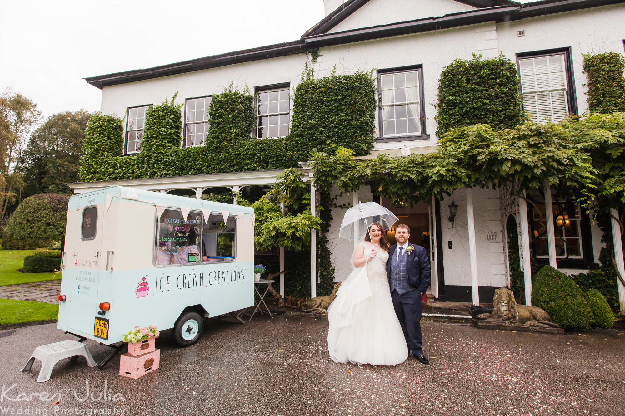 bride and groom portrait next to ice cream van at their Rustic Statham Lodge Autumn Wedding