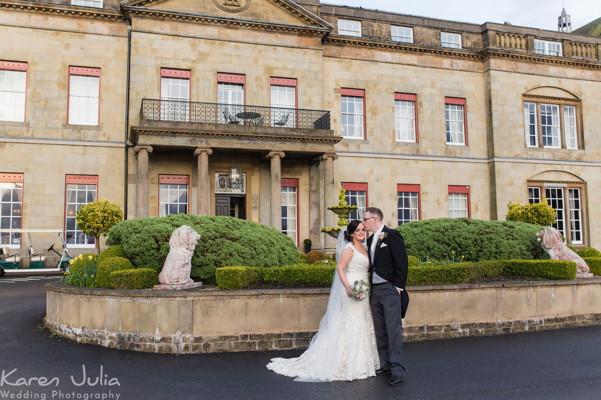 bride and groom portraits outside Shrigley Hall