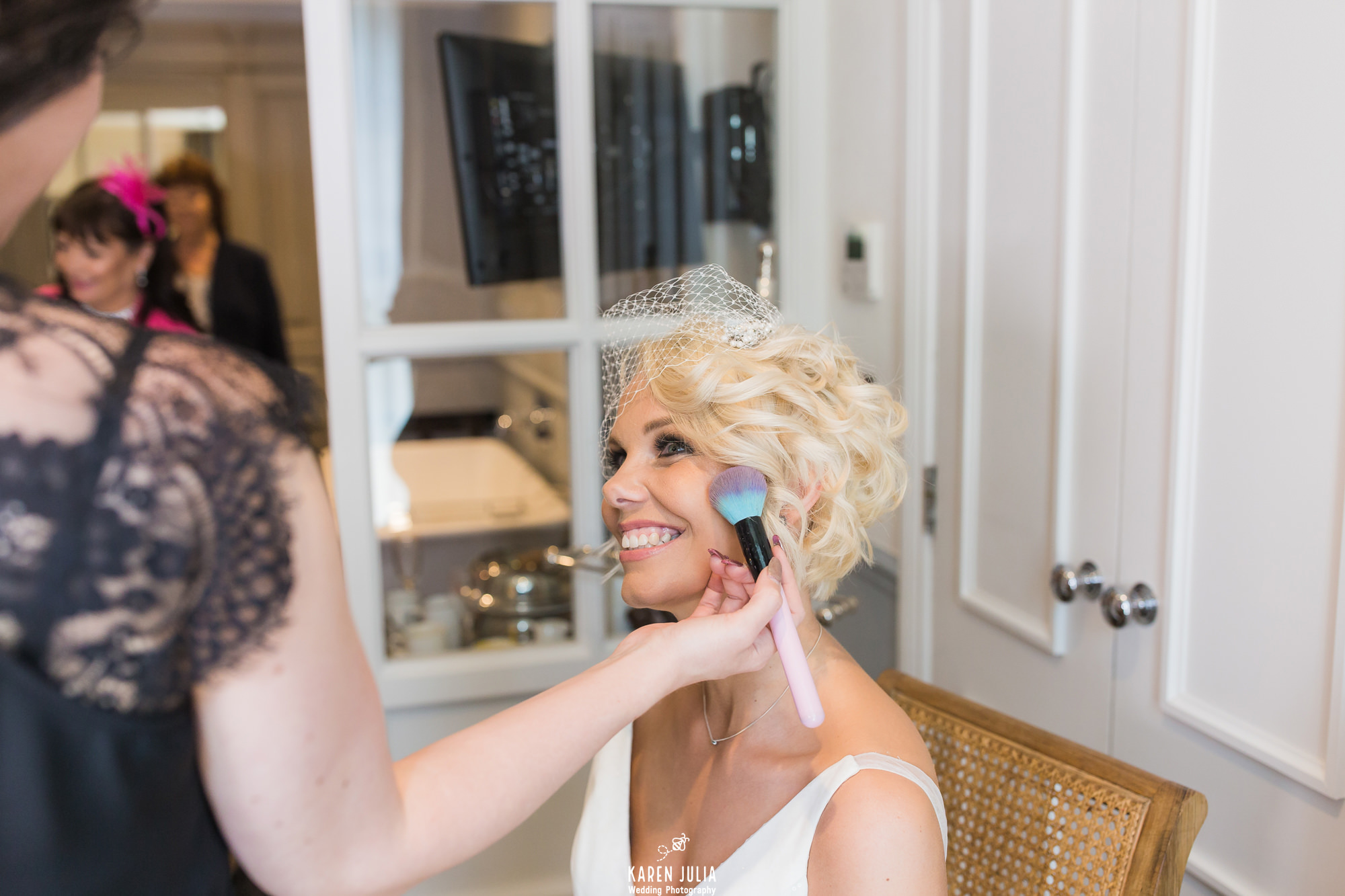 bride having makeup applied in King street Townhouse hotel room