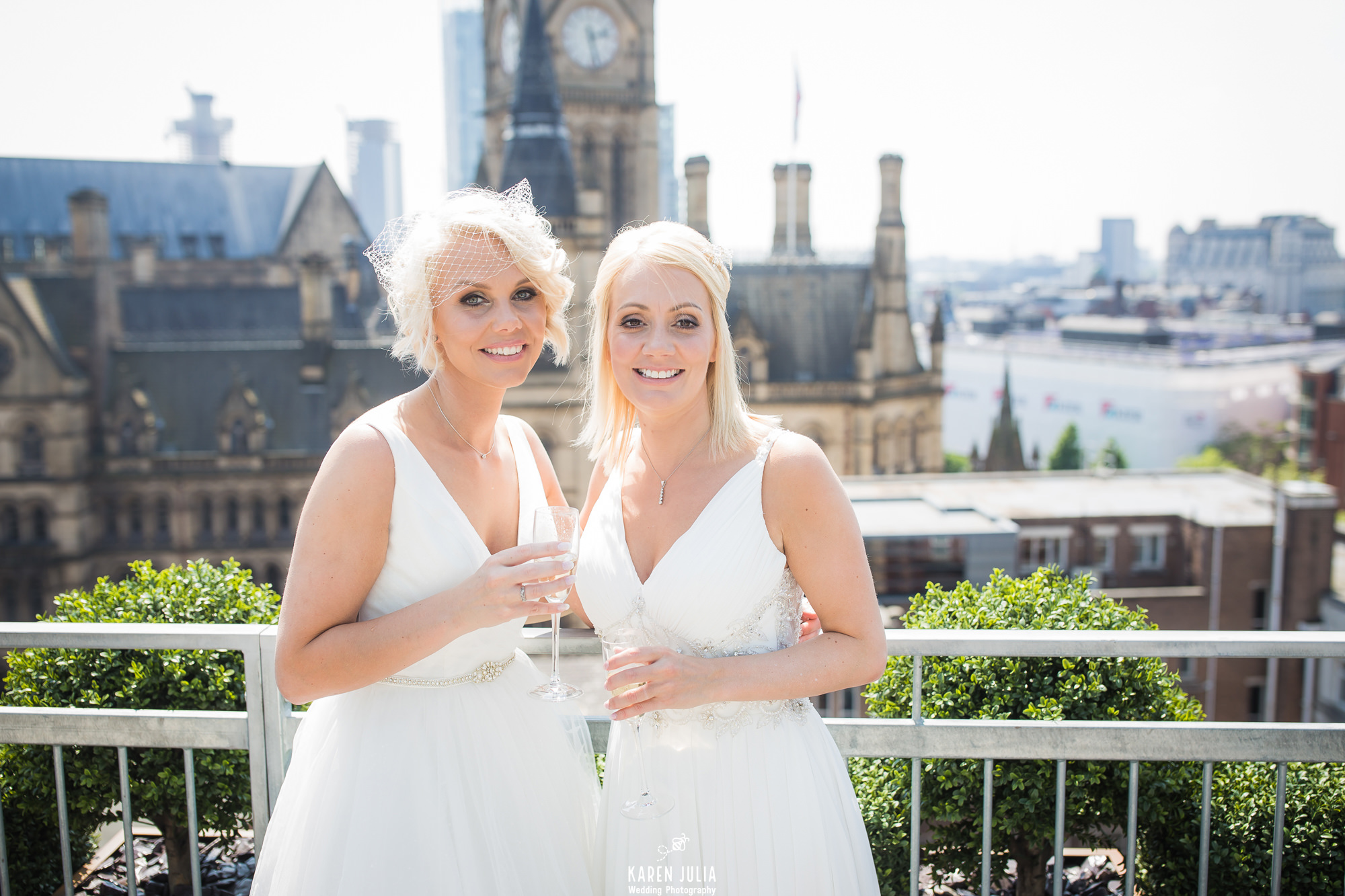 brides pose for a portrait with champagne on the roof terrace at King Street Townhouse