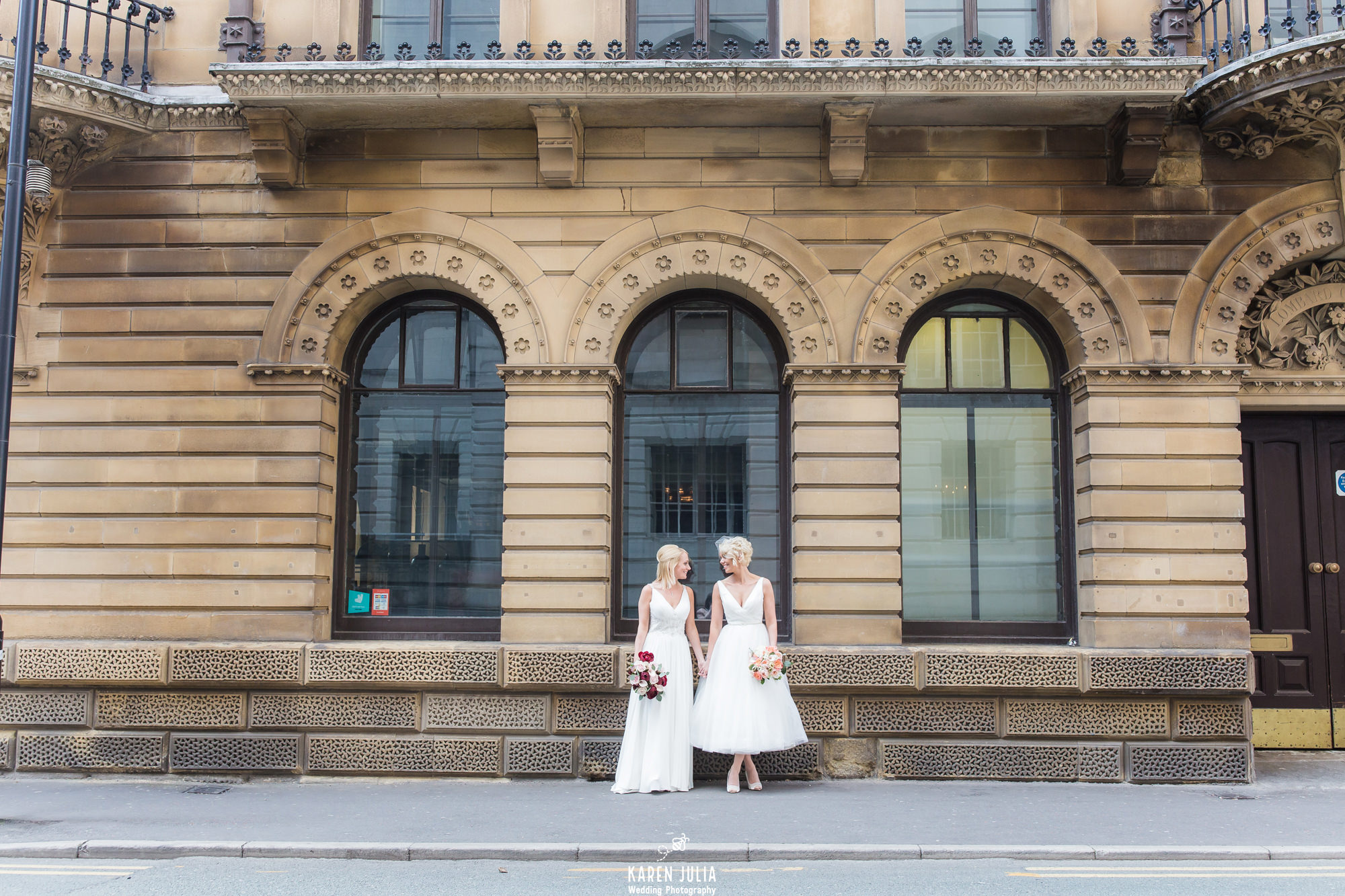 brides standing talking during wedding portraits near King Street Townhouse