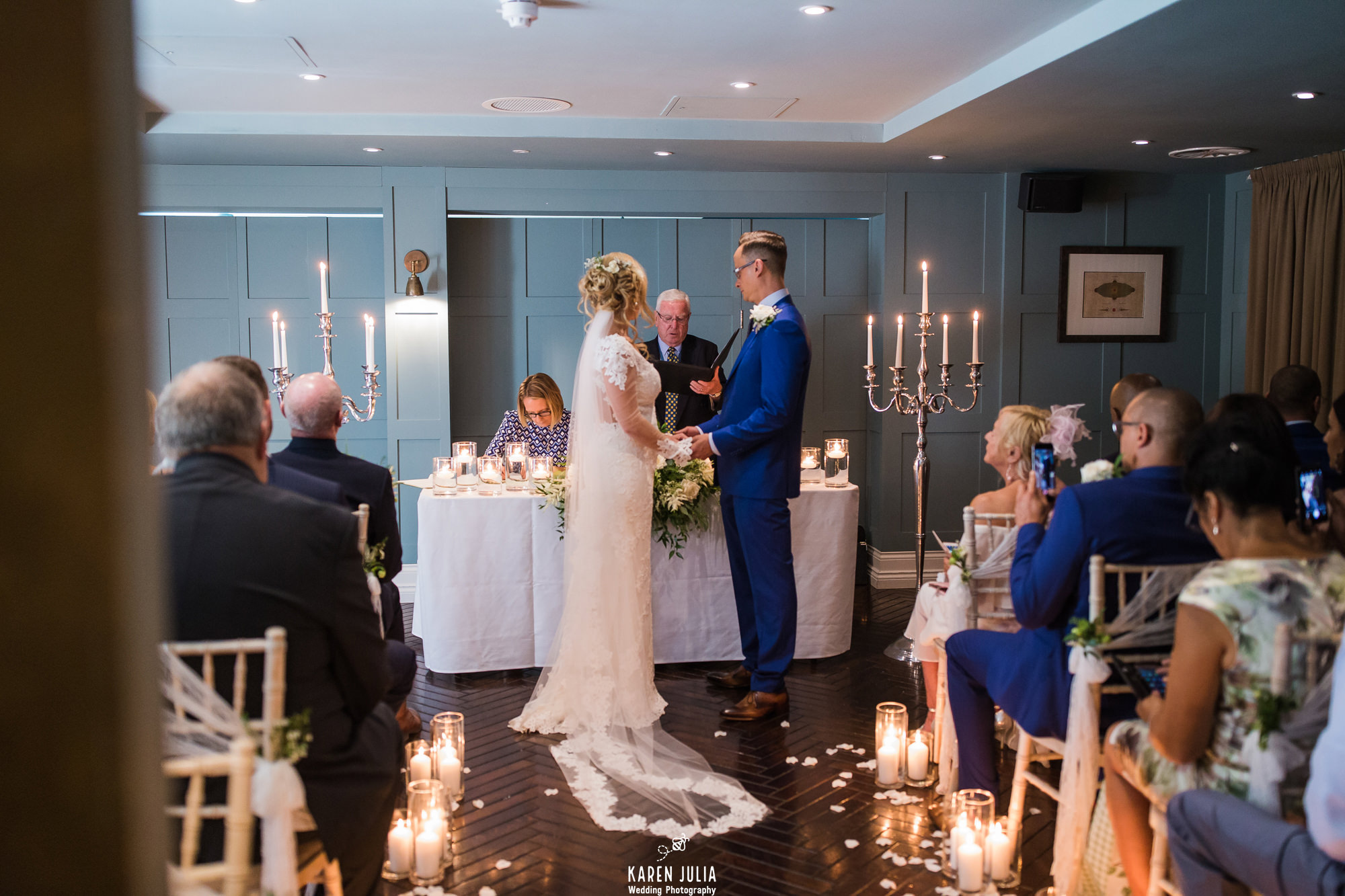 bride and groom exchange vows during wedding ceremony at King Street Townhouse
