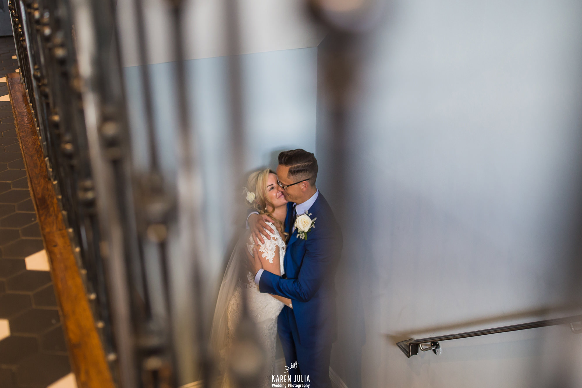 bride and groom embrace on the stairs to the roof terrace at King Street Townhouse Hotel