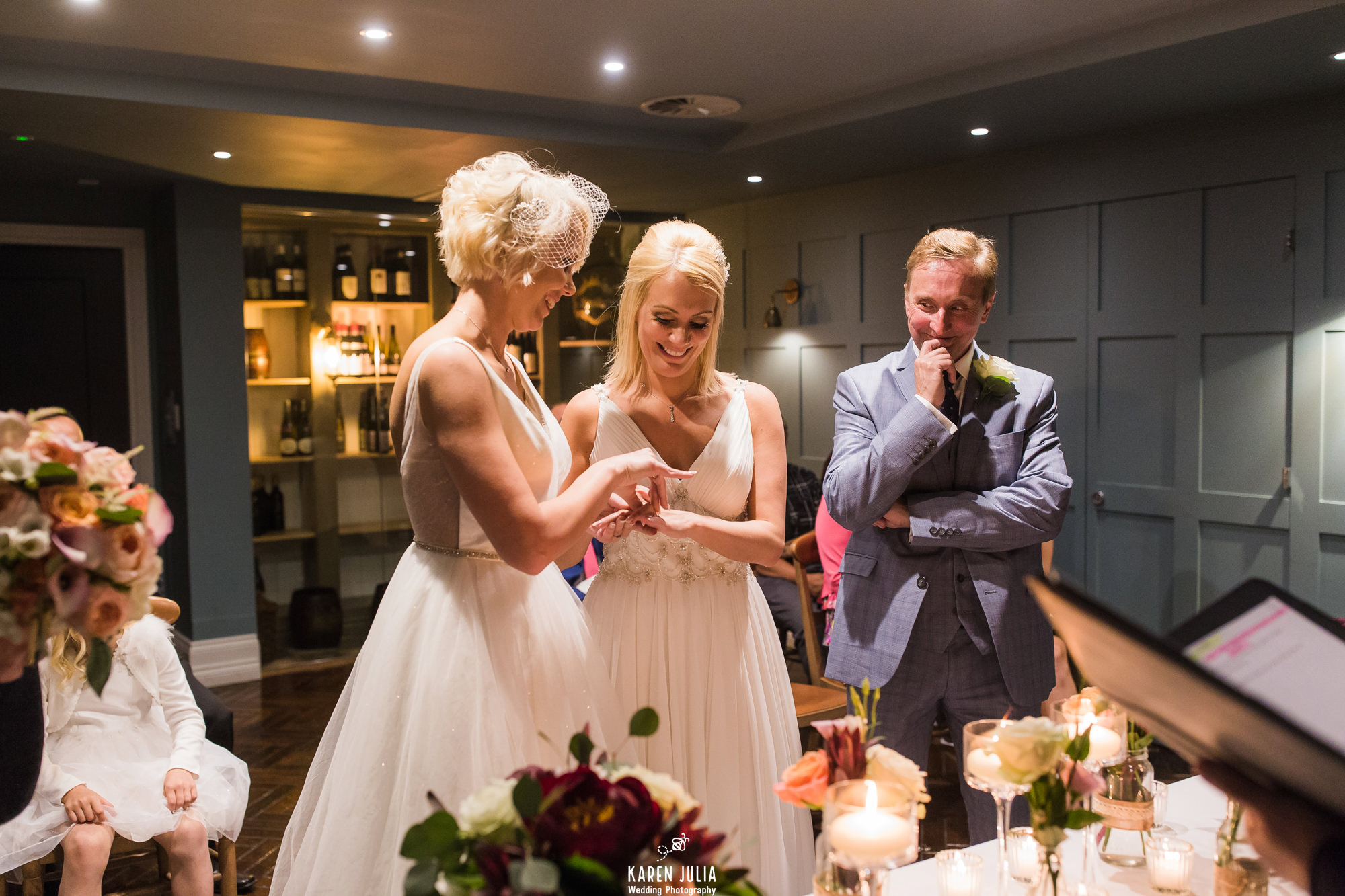 brides exchange rings during wedding ceremony at King Street Townhouse hotel