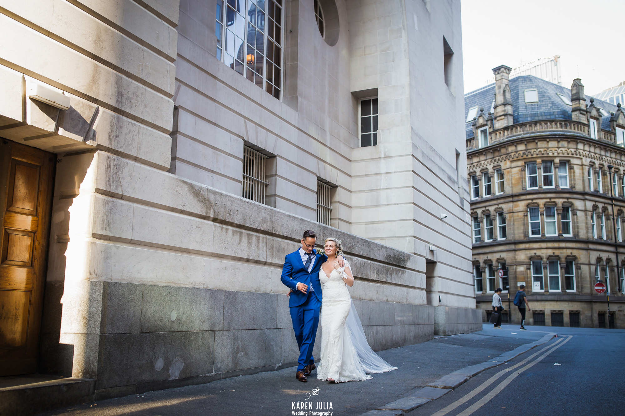 bride and groom walk together near King Street Townhouse